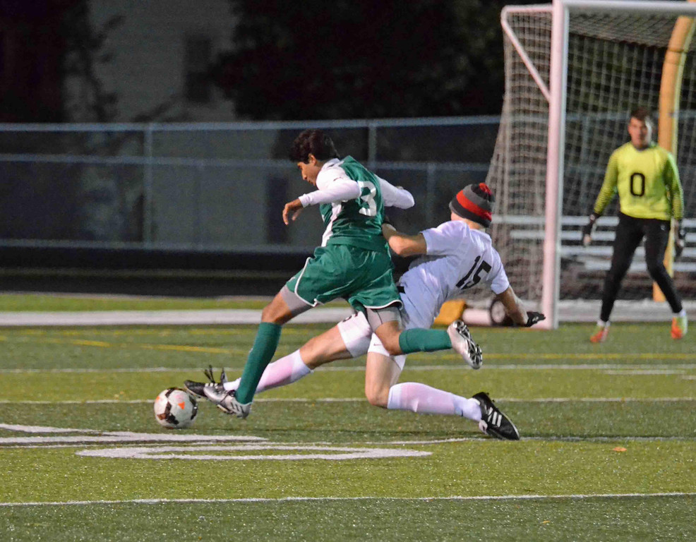 . Paul DiCicco - The News-Herald Brush defender, Carl Kieksi, performs a slide-tackle on a Lake Catholic attacker on Oct 25.