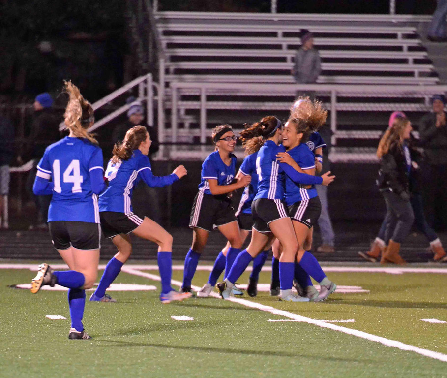 . Paul DiCicco - The News-Herald Madison celebrates their second goal with less than a minute left in regulation to tie the score at two.  Mykala Askew, far right, scored on a shot from 20 yards.  The kick sent the game to double overtime, before Mayfield won on penalty kicks.