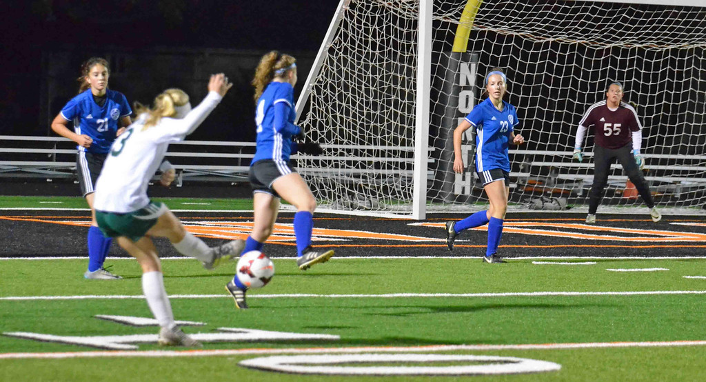 . Paul DiCicco - The News-Herald Mayfield\'s Cassie Lewis, attempting a goal in the first half of play against Madison in the Division I District Finals at Eastlake North on Oct 26.  Mayfield went on to win on penalty kicks.
