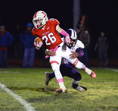 . Aimee Bielozer - The Morning Journal<br> Firelands\' Braeden Casper is brought down from behind by a Keystone defender on Oct. 27.