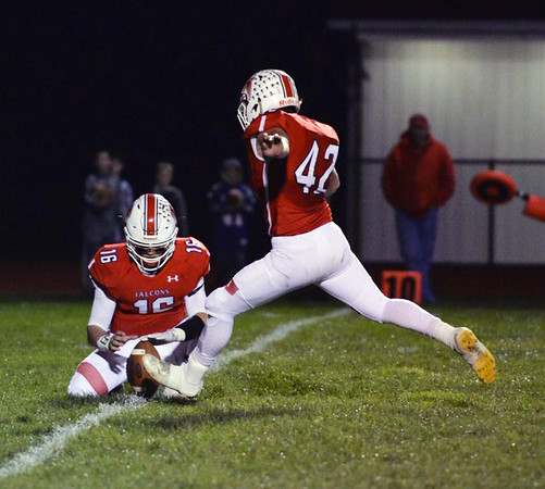 . Aimee Bielozer - The Morning Journal<br> Firelands\' kicker Luke Peterson makes an extra point against Keystone on Oct. 27.