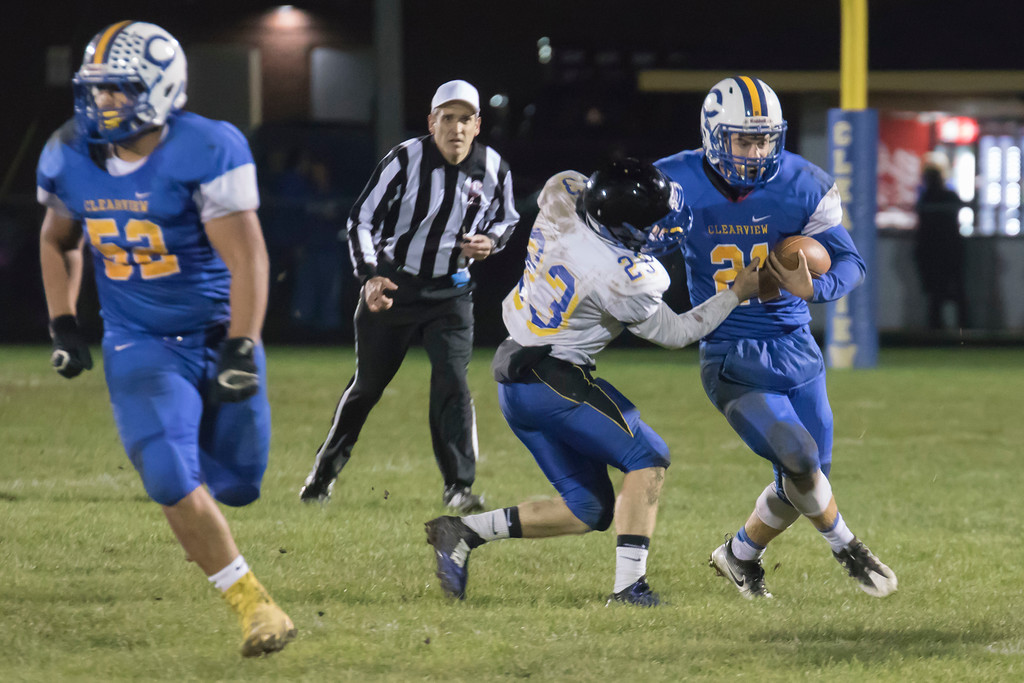 . Jen Forbus - The Morning Journal<br> Clearview running back Drew Engle (21) encounters pressure from Brooklyn defensive back Andrew Zarins on Oct. 27.