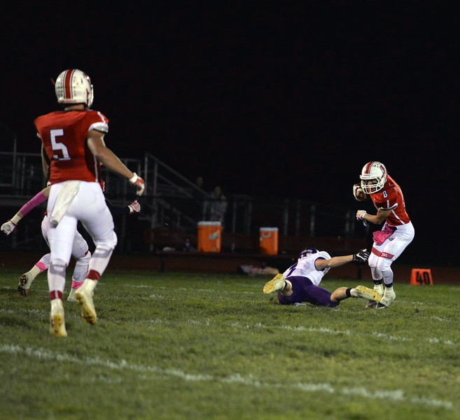 . Aimee Bielozer - The Morning Journal<br> Firelands\' Mason Rogozinski catches a kickoff and shakes a Keystone defender on Oct. 27.