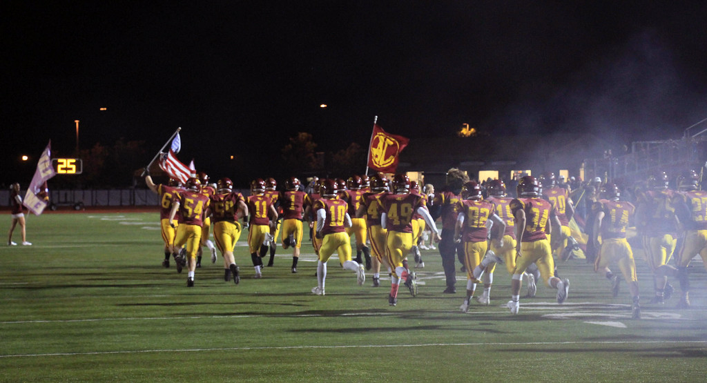 . Nicholas Pfeifer - The Morning Journal<br> Avon Lake takes the field for a game against Midview on Oct. 27.