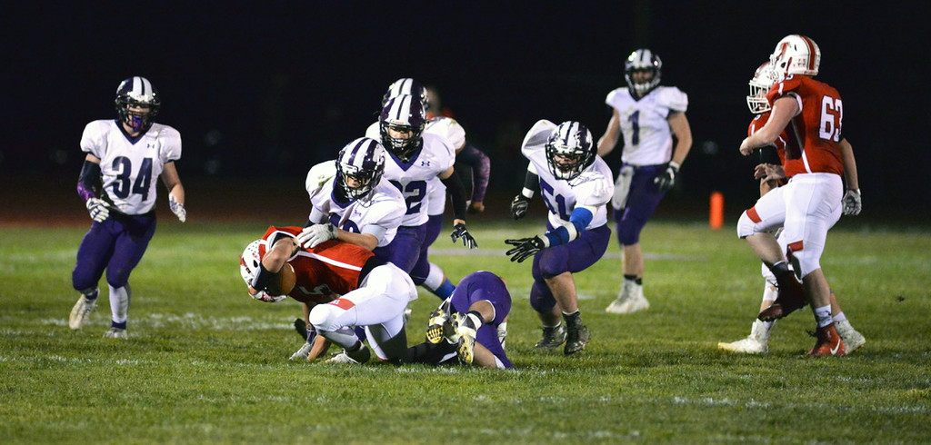 . Aimee Bielozer - The Morning Journal<br> The Keystone defense brings down Firelands quarterback Michael Bansek on Oct. 27.