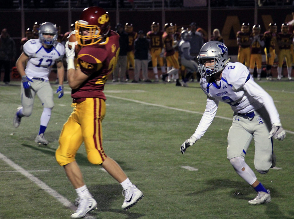. Nicholas Pfeifer - The Morning Journal<br> Avon Lake\'s Kaydn Viancourt brings in a pass for a Shoremen first down against Midview on Oct. 27.