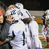 Eric Bonzar—The Morning Journal<br /> Head Coach David McFarland hugs Brandin Sturgill after beating the Cleveland Heights Tigers, 14-13, and clinching their first Lake Erie League Conference championship in school history, Oct. 28, 2016.