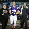 Randy Meyers - The Morning Journal<br /> Avon senior Chris Kozel is escorted by his parents Tom and Sharon on senior night.