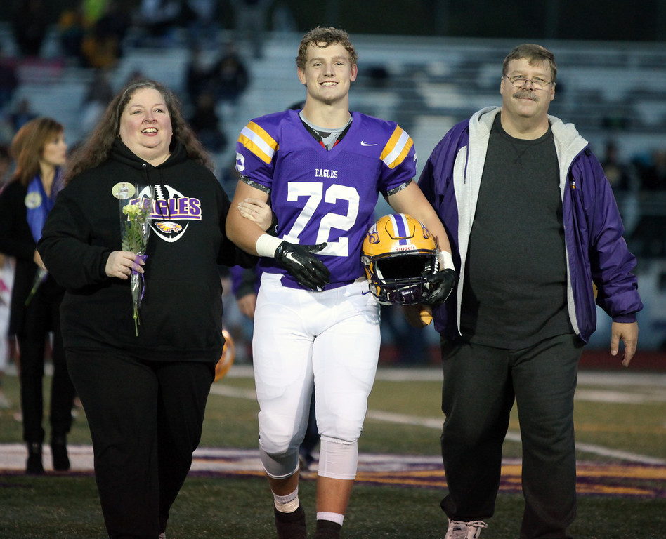 . Randy Meyers - The Morning Journal Avon senior Chris Kozel is escorted by his parents Tom and Sharon on senior night.