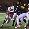 Eric Bonzar—The Morning Journal<br /> Lorain Titans running back Carlos Chavis (33) cuts through the Cleveland Heights defense, Oct. 28, 2016.