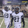 Eric Bonzar—The Morning Journal<br /> Lorain Titans' Naz Bohannon (15) and Zion Cross (21) celebrate after beating the Cleveland Heights Tigers, 14-13, and clinching their first Lake Erie League Conference championship in school history, Oct. 28, 2016.