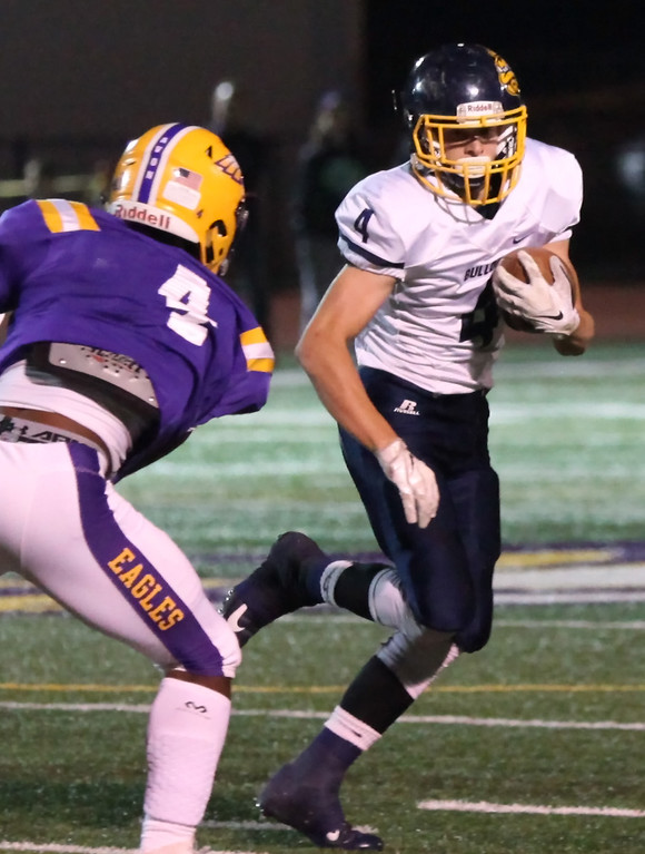 . Randy Meyers - The Morning Journal Olmsted Falls running back Josh Jaeckin turns the corner past Avon\'s Tony Eberhardt for a big gain during the first quarter Oct. 28.