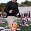 Randy Meyers - The Morning Journal<br /> Avon coach Mike Elder speaks to his players during  warm ups prior to Friday's game against Olmsted Falls.