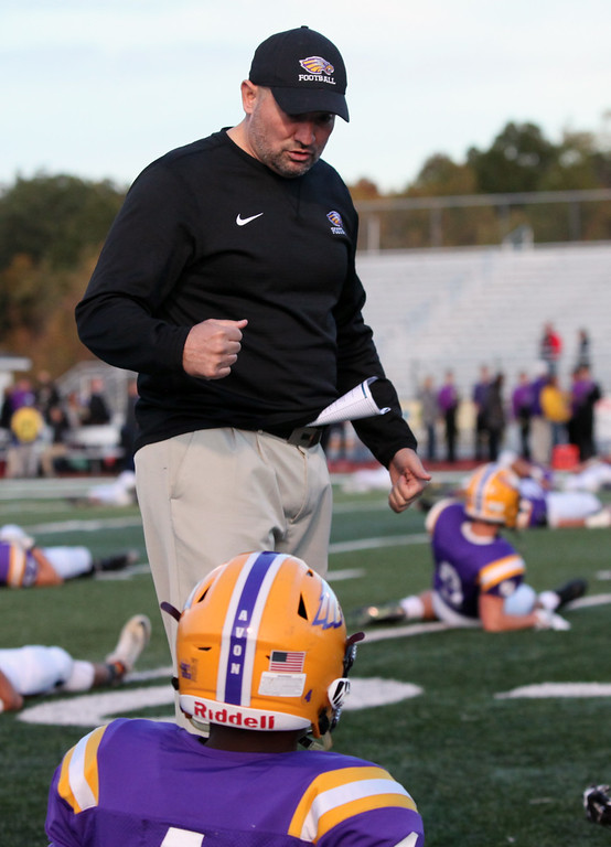 . Randy Meyers - The Morning Journal Avon coach Mike Elder speaks to his players during  warm ups prior to Friday\'s game against Olmsted Falls.