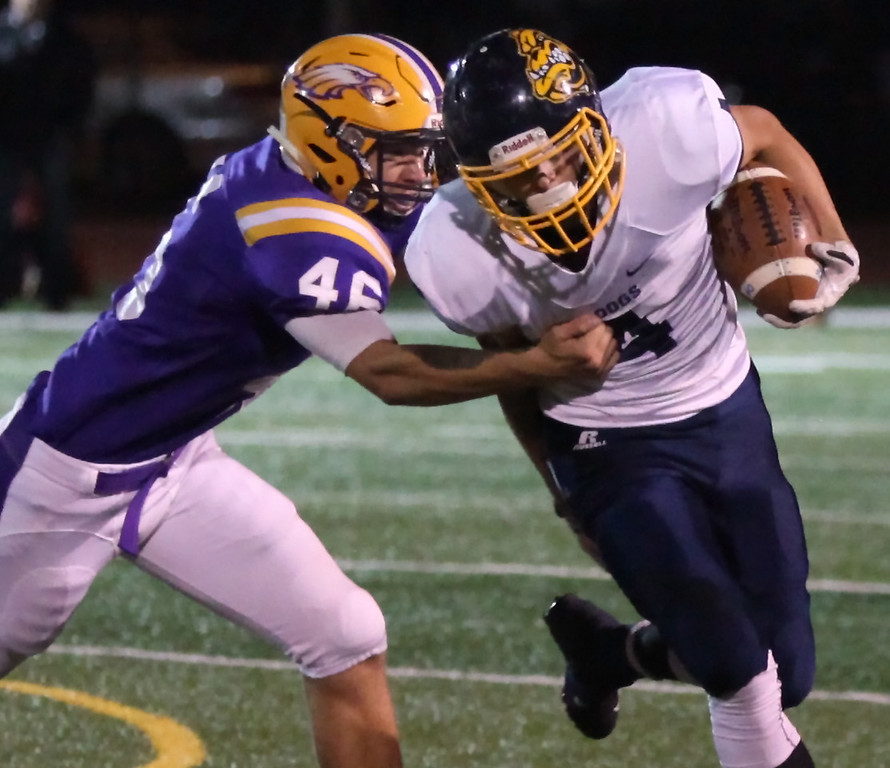 . Randy Meyers - The Morning Journal Josh Jaeckin of Olmsted Falls breaks the tackle by Avon\'s Will Kocar for a big gain during the first quarter on Oct. 28.