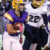 Randy Meyers - The Morning Journal<br /> Avon running back Mason McLemore runs past Tommy Pettry of Olmsted Falls for a gain during the first quarter on Oct. 28.