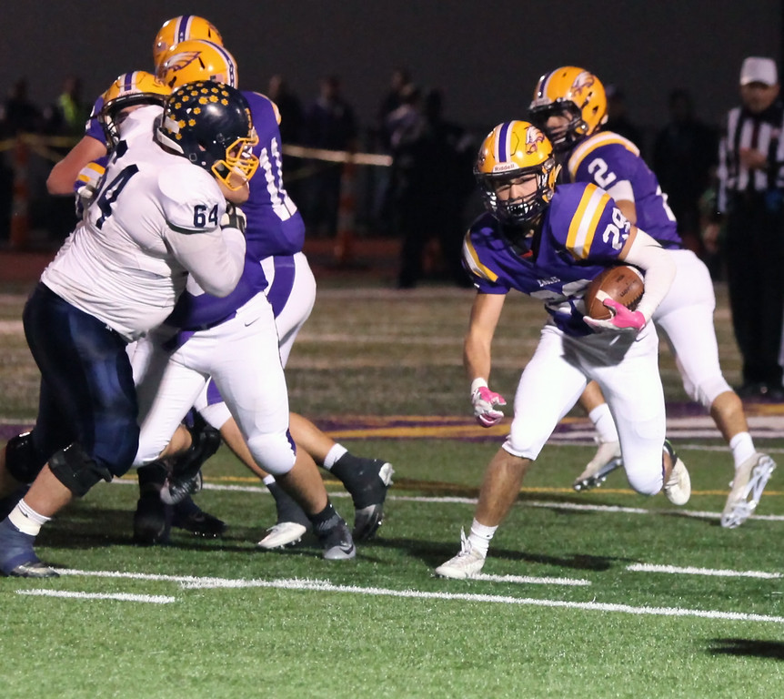 . Randy Meyers - The Morning Journal Avon running back Mason McLemore gets a block from his offensive line and gains big yards during the second quarter against Olmsted Falls on Oct. 28.