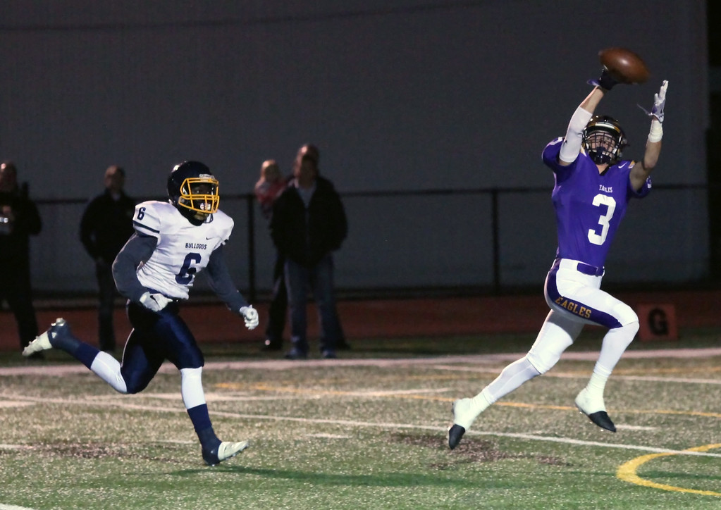 . Randy Meyers - The Morning Journal Avon\'s Mitch Cooper separates from Michael Howard of Olmsted Falls for a first quarter touchdown on Oct. 28.