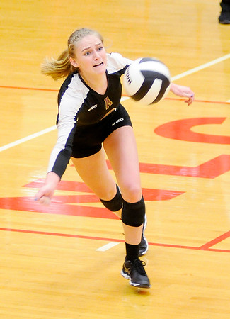 Don Knight | The Herald Bulletin<br /> Alexandria's Megan Miller lunges for a dig during the volleyball semistate at Plymouth High School on Saturday.