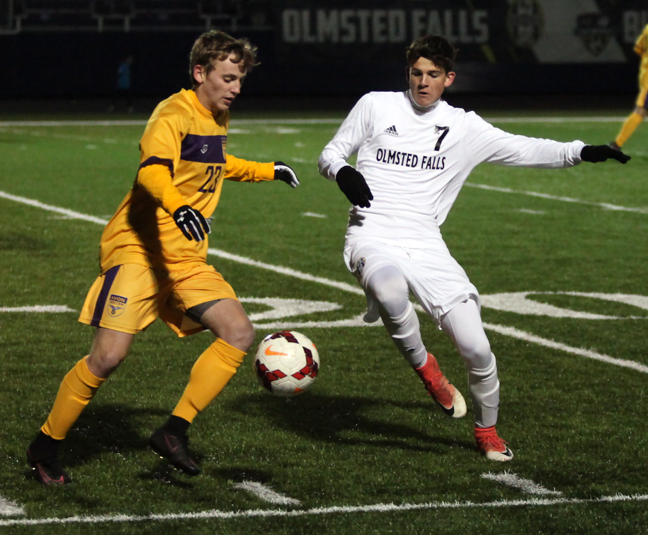 . Randy Meyers - The Morning Journal<br> Grant Espey of Avon battles Danny Cleary of Olmsted Falls for the ball near the sideline during the first half of the Division I Elyria District final on Oct. 28 at North Ridgeville.