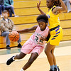 Don Knight   The Herald Bulletin<br /> Pendleton Heights' Leonie Wilson drives the baseline against Marion's Markeisha Jackson on Tuesday.