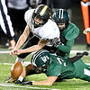 Mt. Vernon quarterback Gehrig Slunaker looses the ball as he is hit by Pendleton defenders Caden McClain and Christian Roberts. The Arabians recovered the fumble.
