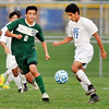 John P. Cleary | The Herald Bulletin<br /> Pendleton Heights Sebastian Quintero and Hamilton Southeastern's Ethan Pulliam chase after the ball during their sectional match Monday.