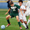John P. Cleary | The Herald Bulletin<br /> Pendleton Heights Elijah Bauer tries to fight off Hamilton Southeastern's Jimmy Maulucci while controlling the ball.