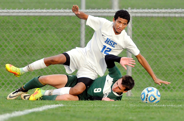 John P. Cleary   The Herald Bulletin<br /> Pendleton Heights Thomas Quiroga and Hamilton Southeastern's Kobe Jones take each other out as they were going after the ball.