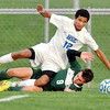 John P. Cleary | The Herald Bulletin<br /> Pendleton Heights Thomas Quiroga and Hamilton Southeastern's Kobe Jones take each other out as they were going after the ball.