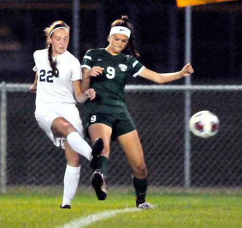 John P. Cleary |  The Herald Bulletin<br /> Muncie Central's Ayala Wilson and Pendleton's Helena Talbot fight over the ball.