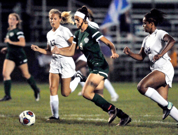 John P. Cleary |  The Herald Bulletin<br /> Pendleton's Helena Talbot splits the Muncie Central defense to get an open shot and score for the Arabians.