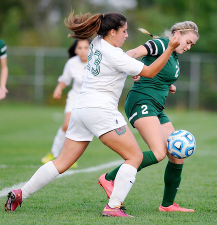 Don Knight | The Herald Bulletin<br /> Anderson's Breanna Llamas challenges Pendleton Heights' Alicia Schrink for control of the ball in the opening game of the girls soccer sectional at Noblesville on Tuesday.