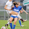 Don Knight | The Herald Bulletin<br /> Pendleton Heights' Helena Talbot collides with Hamilton Southeastern's Rylee Nichwitz during the sectional semifinal on Thursday.