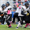 Don Knight | The Herald Bulletin<br /> Madison-Grant quarterback Dylan Brooks hands off to running back Randall Fultz as the Argylls traveled to Elwood on Friday.