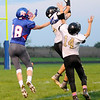 Don Knight | The Herald Bulletin<br /> Madison-Grant's Seth Lugar makes an interception on a pass intended for Elwood's Hunter Scholl on Friday.