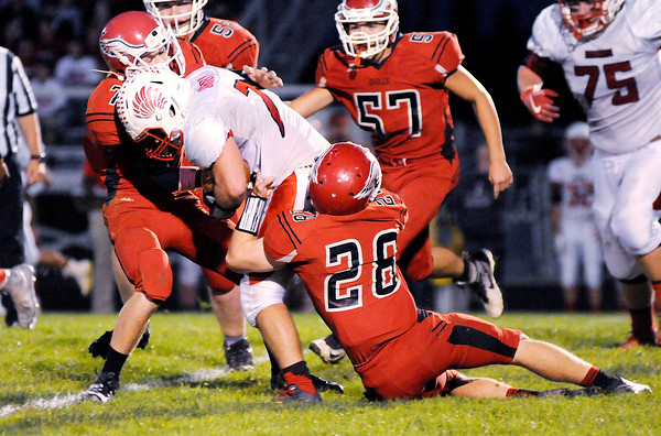 Don Knight | The Herald Bulletin<br /> Frankton's Cody Klettheimer (28) and Brock Threet (7) tackle Mississinewa's Costan Ormsby on Friday.