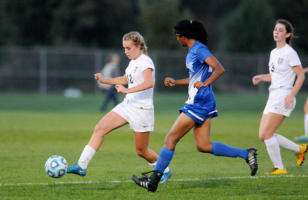 Don Knight | The Herald Bulletin<br /> Hamilton Southeastern's Saanika Kamat comes up to challenge Pendleton Heights Lexi Hill in the sectional semifinal at Noblesville on Thursday.
