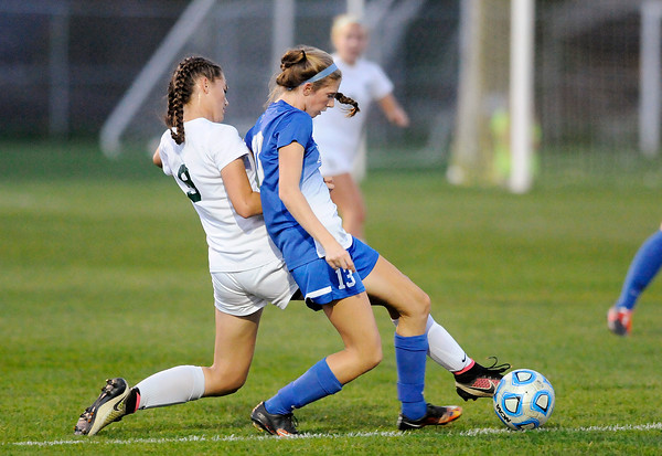 Don Knight | The Herald Bulletin<br /> Pendleton Heights' Helena Talbot challenges Hamilton Southeastern's Claire Elchorts for control of the ball during the sectional semifinal at Noblesville on Thursday.