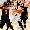 Don Knight | The Herald Bulletin<br /> Madison-Grant's Danyelle Hutson splits Taylor's Alison Pemberton and Brooklynn Campbell on a drive into the lane as the Argylls hosted the Titans on Tuesday.