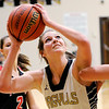 Don Knight | The Herald Bulletin<br /> Madison-Grant's Hannah Hawkins shoots from the low post as the Argylls hosted Taylor on Tuesday.