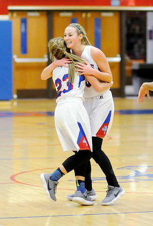 Don Knight |  The Herald Bulletin<br /> Elwood's Gabby Leavell, right, gets a hug from teammate Sherrie Taylor as the Panthers celebrate Leavell's 1000th career point as the Panthers hosted the Marion Giants on Wednesday.