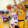 Don Knight |  The Herald Bulletin<br /> Elwood's Gabby Leavell drives to the basket against Marion's Ra Shaya Kyle on Wednesday.