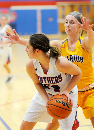 Don Knight |  The Herald Bulletin<br /> Elwood's Caroline Daughtry looks to pass as she is guarded by Marion's  Kaylynn Scher on Wednesday.