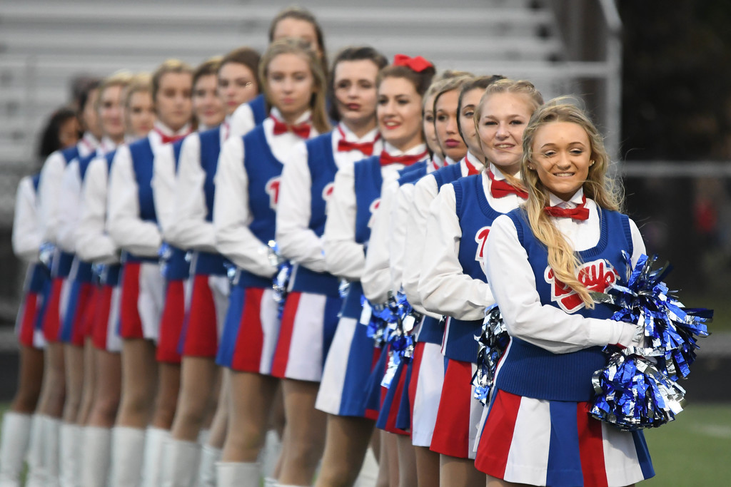. Eric Bonzar�The Morning Journal <br>  The Bay Rockets cheerleaders hold the line during the playing of the school\'s alma mater, before the team\'s game against the Rocky River Pirates, Sept. 29, 2017.