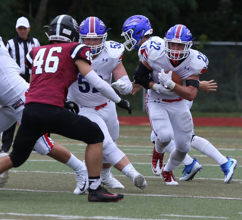 . Randy Meyers - The Morning Journal<br> Bay running back Trey Psota looks for a block from offensive lineman Sean Heideloff against University on Sept. 2.