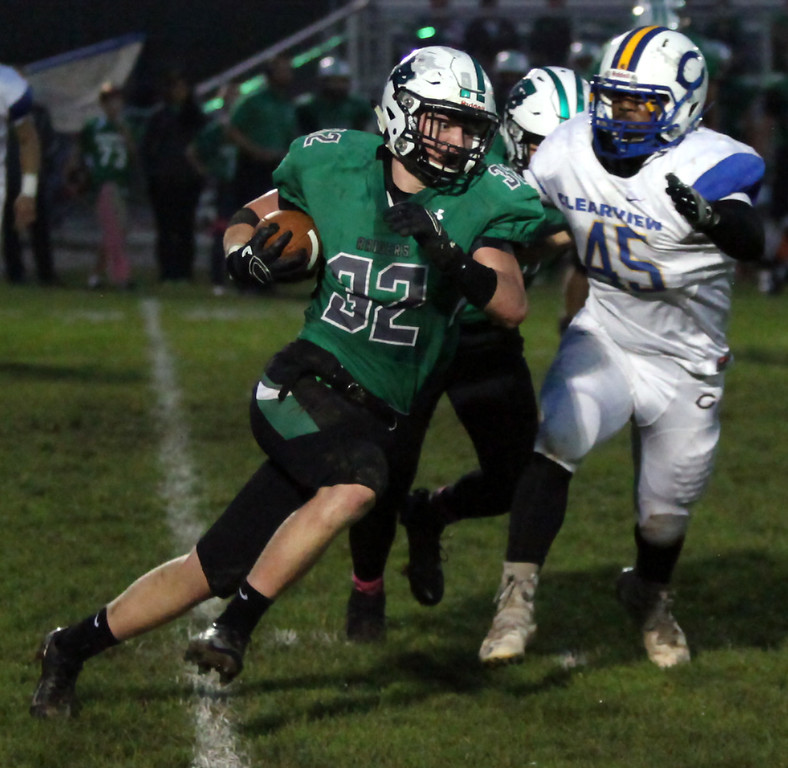 . Randy Meyers - The Morning Journal<br> Columbia\'s Cole Schwartz runs by Clearview\'s Kahliel Fenderson for a gain during the first quarter on Oct. 6.
