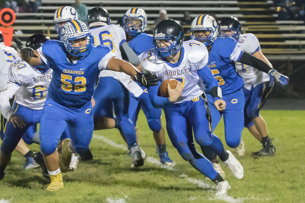 . Jen Forbus - The Morning Journal<br> Brooklyn quarterback Matt Crossman looks for room to move up field as Clearview defensive tackle Collin Manning (52) applies pressure on Oct. 27.