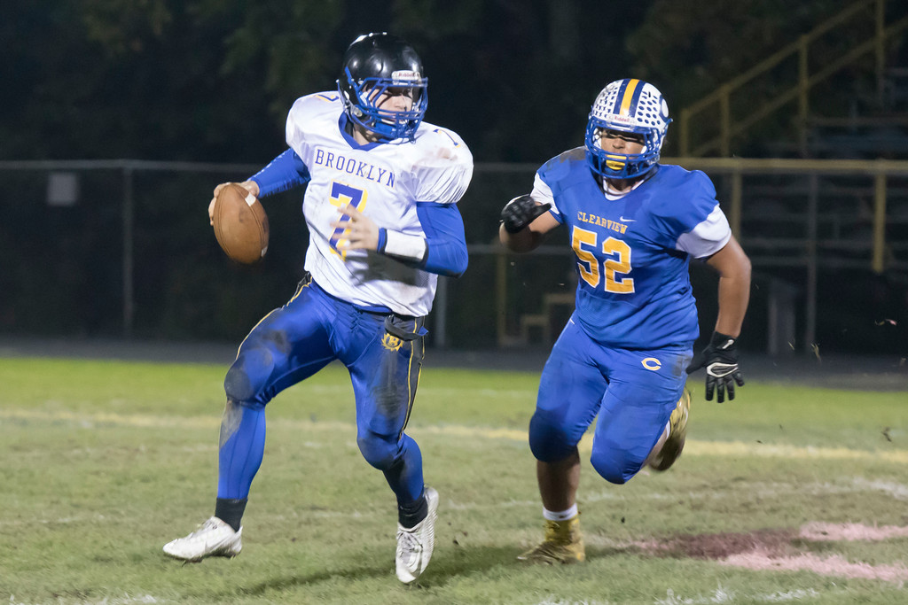 . Jen Forbus - The Morning Journal<br> As Brooklyn quarterback Matt Crossman (7) looks for an open receiver, Clearview defensive tackle Collin Manning (52) closes in on Oct. 27.
