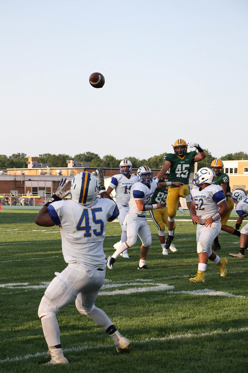 . Nicholas Pfeifer - The Morning Journal<br> Clearview quarterback Anthony Terry throws a strike to Kahliel Fenderson (45) against Amherst on Aug. 25.